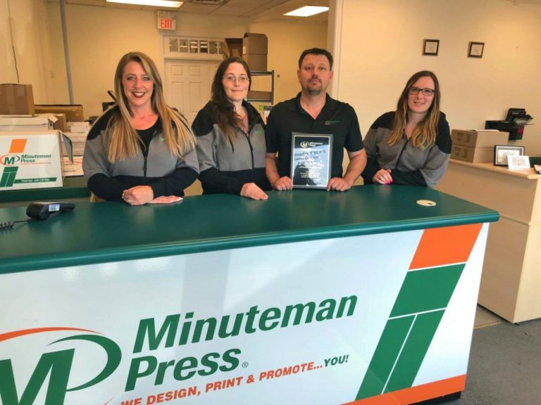 Karen McArthur and Jeff Wereley (middle) own the Minuteman Press design, marketing, and printing franchise in Guelph, Ontario, Canada. https://minutemanpressfranchise.ca